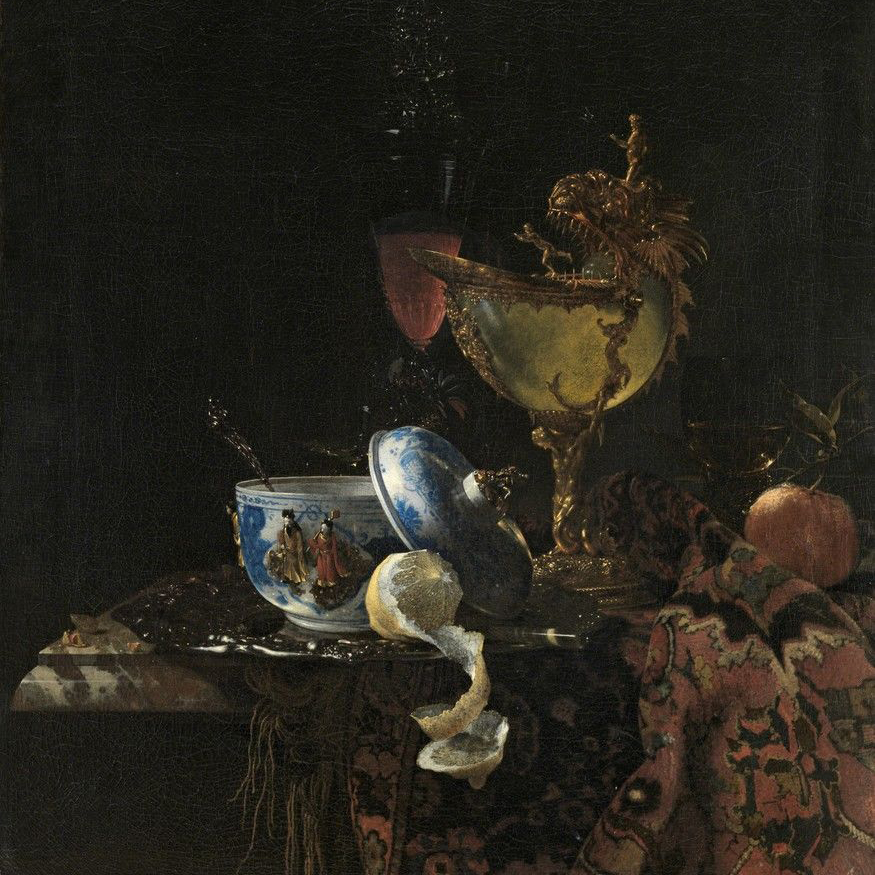 An early example of Dutch Golden Age painting by Willem Kalf (1619-1693), entitled Still Life with a Chinese bowl, a Nautilus Cup and Fruit (1662).